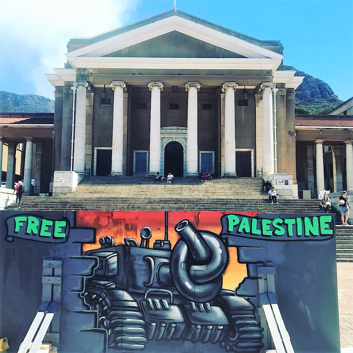 graffiti art Free Palestine at UTC depicting a tanl with its muzzle tied in a knot